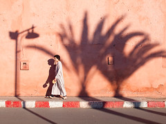 Moroccan evening (Evgeni Zotov) Tags: africa street city pink shadow red people man color lamp bread evening pavement walk morocco shade maroc marocco maghreb marrakesh lantern marruecos marokko moroccan marrocos roadway fas khobz marocko trea khubz djellaba maroko   jellaba