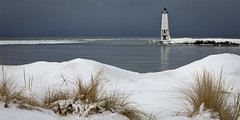 Frankfort North Breakwater Light (Luke Hertzfeld) Tags: travel winter lake cold history ice beach water grass sand steel historic lakemichigan shore icy shipping beacon navigation breakwater fresnellens keeper westmichigan uscoastguard unitedstatescoastguard benziecounty betsieriver frankfortmichigan greasses frankfortnorthbreakwaterlight frankfortlight puremichigan lakemichiganlighthousetour greatlakelighthousetour nationalhistoriclighthousepreservationact crystallaketownship