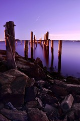 The Glowing Night (TLW Photography) Tags: ocean new wood york city nyc longexposure pink light sunset red sea blur color art texture abandoned beach water colors lines night digital dark lost island photography star pier photo moving blurry sand nikon focus marine rocks long exposure alone quiet escape purple heart stones getaway relaxing large peaceful calm gone abandon forgotten romantic nights mystical lonely dslr relaxation depth tranquil gem tlw startrails despondent cityisland tomasz wasik colorphotoaward d40x d7000 tlwphotography tomaszwasik tomaszwasiktlwphotography tlwphotographytomaszwasik