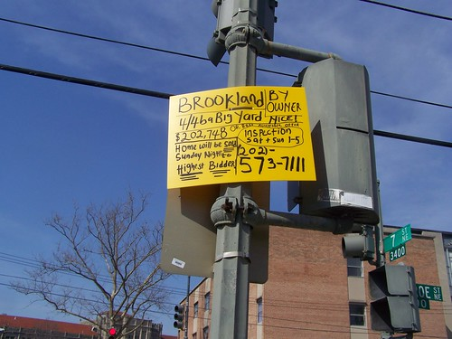 "A ""for sale"" sign on a streetlight in Brookland by rllayman"