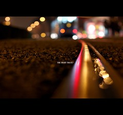 Even if you are on the right track, you will get run over if you just sit there. (*karla) Tags: city night canon 50mm track dof bokeh f14 tram