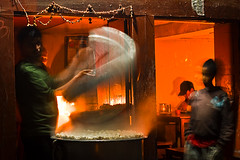 A teashop owner cooking momos (Julien Dorol) Tags: nepal light food night restaurant cafe momo asia candle drink eating watching teashop chineesefood tibetanfood mouving