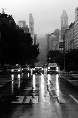 Park Avenue under the rain (Airicsson) Tags: park street new york city nyc summer urban blackandwhite bw usa white ny black car rain island lumix us traffic walk manhattan panasonic rainy avenue 2010 streetshot blackwhitephotos lx3
