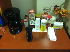 Coffee pot, coffee mug, condiments.