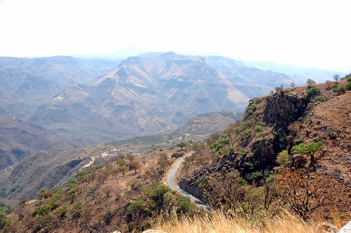Geological striations in mesa ridges, bend in the road, rural Hill and valleys near San Cristobal de la Barranca, Jalisco, Mexico by Wonderlane