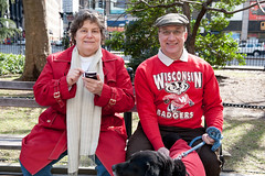 Couple from Wisconsin at Rally to save the American Dream, New York City (jackie weisberg) Tags: newyorkcity red usa dog ny newyork wisconsin us couple unitedstates union rally protest badgers unions newyorkstate protestors protestmarch rallies manandwife wisconsinbadgers jackieweisberg savetheamericandream