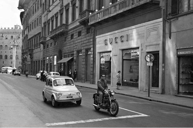 Courtesy of Foto Locchi- A Fiat 500 passes the Gucci store on Via Tornabuoni in Florence, circa1962