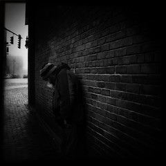 (dwknight912) Tags: street city portrait urban man brick cars hat fog wall dark square person lights traffic breath foggy atmosphere chilly backagainstthewall visiblebreath