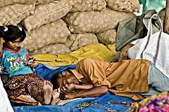 Siesta and the Cell Phone (A n i r b a n) Tags: bangalore marketplace madivala