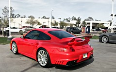 Porsche 997 GT2 (Monkey Wrench Media) Tags: red yellow race track martin display rott side rear profile 911 wing racing german porsche coupe dealership aston astonmartin exhaust gt2 spoiler dealer dbs 997 calipers 9971 yellowcalipers redtaillights