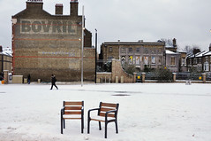 DSC_4649 [ps] - Ice Cold Bovril (Anyhoo) Tags: city uk winter england urban white house snow cold building brick london ice sign wall advertising chair chairs furniture advertisement advert streetfurniture brixton ghostsign tategardens anyhoo windrushsquare brixtonoval photobyanyhoo