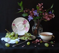 The Spring Supper. (Esther Spektor) Tags: pink flowers light stilllife white reflection green cup glass leaves silver golden petals stem artistic tea blossom napkin creative violet plate fork explore ornament vase bouquet dishes kiwi 1001nights grape porcelain naturemorte coth sauser bej