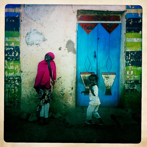 Teenage Girl And Her Sister Outside An Old Painted House, Baligubadle, Somaliland