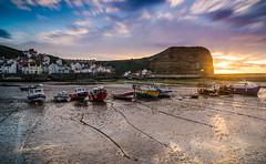 Stuck (Ian Allon) Tags: staithes england unitedkingdom gb harbour boats leefilters superstopper sunset village mud clouds longexposure