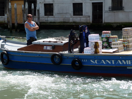 Transporting bottled drinks by water, Venice, Italy