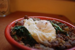 Poached egg on beans and quinoa