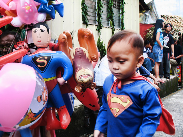 superman kid and toy at Lucban, Quezon during Pahiyas