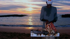Sunset Barbeque (16:9clue) Tags: africa sunset food holiday fish travelling beach smile fun fisherman widescreen joy crab roast grill morocco shore seafood pointandshoot barbeque pescado crustacean poisson 169 2009 roasting spidercrab travelphotography giantcrab oualidia freshcrabs 169clue