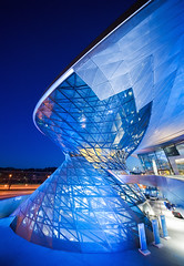 BMW World III (Philipp Klinger Photography) Tags: world longexposure blue windows light shadow afghanistan color detail window car museum architecture female night facade germany munich mnchen bayern deutschland bavaria evening nikon triangle factory angle geometry tripod wide wideangle bmw bluehour philipp welt klinger nadir bmwwelt bmwworld d700 dcdead flensbugr
