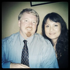 Me at forty-three with my wife Ling. She takes extremely good care of me, and if I screw up...she whacks me with the mop. by ObieVIP