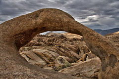 Storm Troopin at Mobius Arch (Dave Toussaint (www.photographersnature.com)) Tags: california ca travel sky usa cloud storm nature rock photoshop canon landscape photo interestingness interesting skies arch photographer hole cs2 picture sierra explore adobe granite geology southerncalifornia sierranevada hwy395 lonepine 2008 eastern hdr adjust easternsierras infocus highway395 alabamahills photomatix denoise 40d topazlabs mobiusarch photographersnaturecom davetoussaint