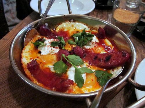 Baked eggs for two, tomato and pepper ragout and greek yoghurt with chorizo