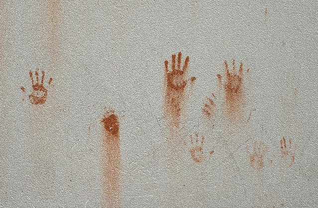 Children prints 1 in a wall
