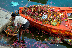 and one man to clean it (nicocrisafulli) Tags: travel india colors boats photography ganga ganges varnasi canont1i