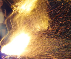 captivating flares (mel cobcroft) Tags: orange girl yellow fire australia campfire tasmania sparks sonycybershot 2011 melcobcroft melaniecobcroft