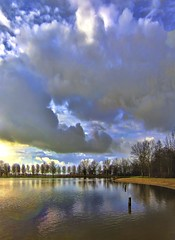 cloudy (Wim Koopman) Tags: trees sky holland beach water netherlands dutch clouds reflections photography mirror photo pond stock nederland stockphoto stockphotography goudriaan wpk