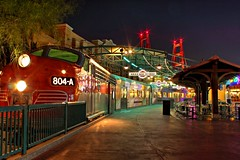 The Color Train... [Explored #19] (Ring of Fire Hot Sauce 1) Tags: color night train reflections lights disneyland shops dca hdr disneycaliforniaadventure photoshopelements californiazephyr photomatix photoscape canont1i