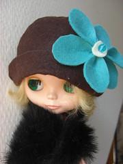 Teal flower on Brown Hat
