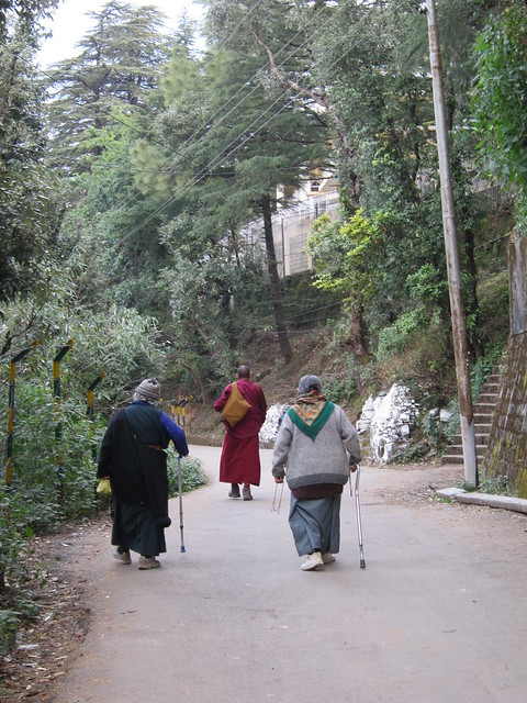 Old Tibetan women and a monk