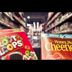 168/365 Cereal Ride (brandonhuang) Tags: light red motion fruit breakfast store movement dof bright market bokeh box cereal super supermarket aisle loops honey boxes nut grocery cheerios cereals cheerio brandonhuang
