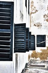 Black Shutters, Elmina Castle, Ghana (MJ Reilly) Tags: wood white black castle wooden nikon open fort many ghana shutters weathered slavery slave elmina d90 elminacastle elminafort