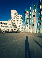 Me & My Shadow (Philipp Klinger Photography) Tags: trip blue windows light sunset shadow summer sky people sun white man detail reflection building me metal architecture silver germany frank deutschland evening nikon europa europe cross harbour capital north gehry x chrome crossprocessing processing nrw shorts dusseldorf hafen dsseldorf rhine philipp frankgehry nordrheinwestfalen xprocessing crossed westfalen zollhafen windo nordrhein klinger rhinewestphalia artchitect d700 crossprocessingx