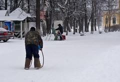 Man-driven sledge (Maxim Melnikov) Tags: winter people snow evening russia outdoor wintergames