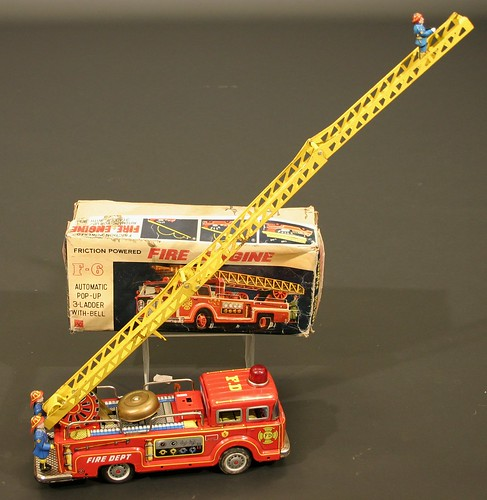 A Japanese friction-powered fire engine with automatic pop-up three sectioned ladder and bell (estimate £60 to £80)