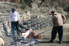 At least the lamb roast was under way. (campfullmonte) Tags: camping nudist naturist safe eco campsite montenegro offgrid clothingoptional