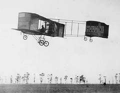 Houdini airborne in his Voisin at Diggers Rest, 1910, by Marcel Poupe (State Library of New South Wales collection) Tags: airplane aircraft aviation aviator biplane magician houdini voisin harryhoudini voisinbiplane