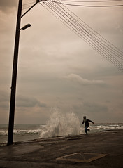 (ssj_george) Tags: road street light sea wild people man wet rain electric lens lumix person side cyprus wave running run pole panasonic rainy wires angry hood pancake 20mm splash jogging raining electrical jog dmc larnaca timing larnaka f17 m43 gf1  georgestavrinos  m43rds ssjgeorge  giorgosstavrinos