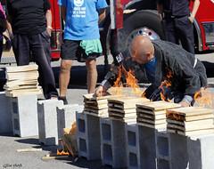 Breaking flaming planks of wood. (Gillian Floyd Photography) Tags: karate chop flaming planks wood fire break