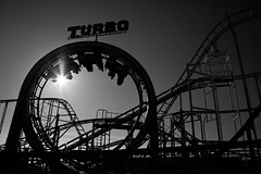 Turbo Charged (Rollercoaster), Brighton Pier (flatworldsedge) Tags: sun white black pier brighton loop tracks turbo flare rails rollercoaster 15000 explored yahoo:yourpictures=motion yahoo:yourpictures=curves