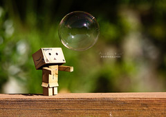 I'm forever blowing bubbles.. (.OhSoBoHo) Tags: japan canon ball garden toy japanese robot sweet bokeh small bubbles mini pop bubble blowingbubbles danbo amazoncojp canoneos40d imforeverblowingbubbles danboard  catchingbubble westhamtheme
