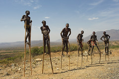 Boys bana walking on stilts. Key Afer.  Ethiopia (courregesg) Tags: africa boy people traditional omovalley anthropologie ethiopia tribe ethnic bana gens afrique tribu eastafrica ethnologie hornafrica