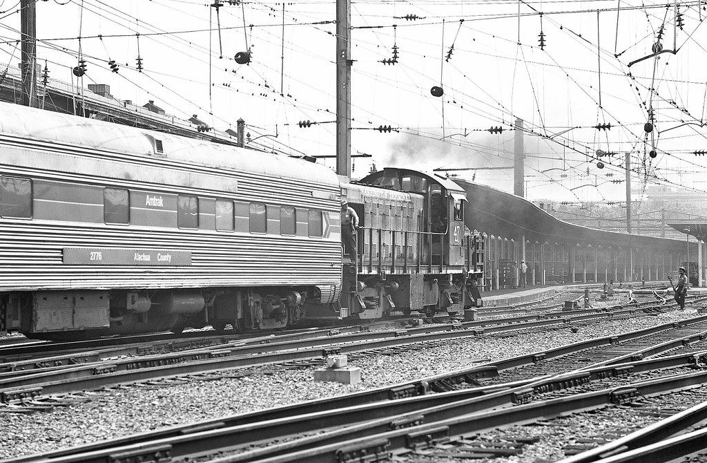 Washington Terminal Company Alco RS-1 switcher # 47, is seen working Amtrak passenger cars to make up a train in Washington Union Station, D.C., June 1976