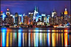 New York City [EXPLORE] (Moniza*) Tags: city nyc newyorkcity longexposure ny newyork reflection water skyline night skyscraper river geotagged newjersey cityscape manhattan illumination midtown explore nightlight esb hudsonriver empirestatebuilding gothamist bluehour unioncity hoboken weehawken gothamcity thebigapple westnewyork lightstream unionhill explored explorefrontpage moniza kingsofflickr