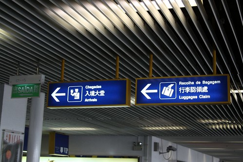 Signage at the Macau ferry terminal: in Portuguese, Chinese and English