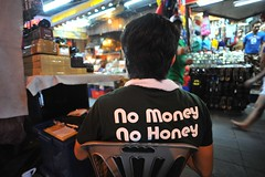 No Money, No Honey, Sukhumwit, Bangkok, Thailand (N3philum) Tags: travel boy portrait man money portraits thailand nikon asia southeastasia child adult bangkok south east adventure honey thai southeast nikkor nomoney sukhumwit nomoneynohoney nohoney d700 nateventure iamluna