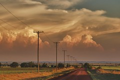 on the road to distant storms - explore (Marvin Bredel) Tags: road sunset oklahoma weather clouds rural evening amazing explore glowing thunderstorm poles storms marvin hdr distant electricline kingfishercounty utilityline marvin908 oklahomathunderstorm therebeastormabrewin nikhdrefexpro bredel marvinbredel